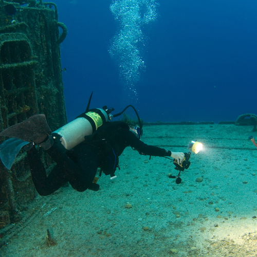 Underwater Photographer with Strobe Firing